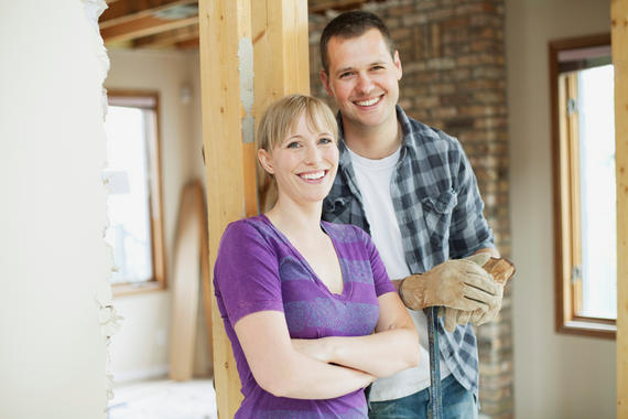 Happy, mid adult couple in house renovation.